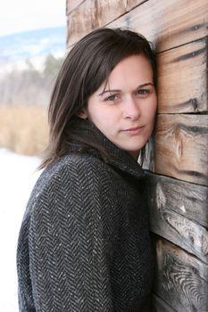 Adult brunette female in a rural setting