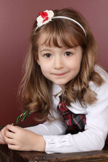 Beautiful little girl with a Christmas candy cane