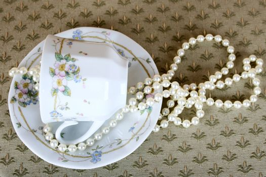 Antique tea cup with pearls