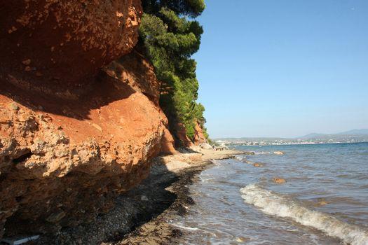 Red rocks on the coast of Aegean Sea close to Nikiti,Greece