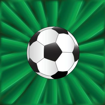 A typical football over a green material background