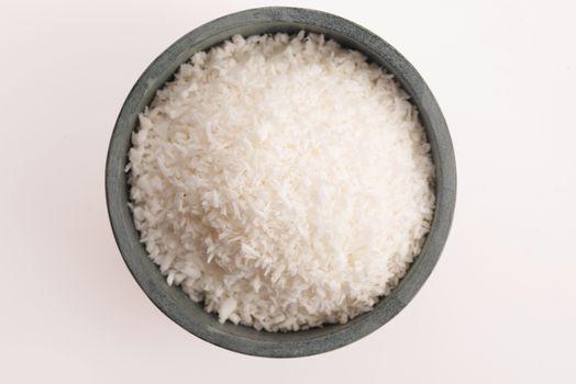 Coconut flakes in ceramic bowl