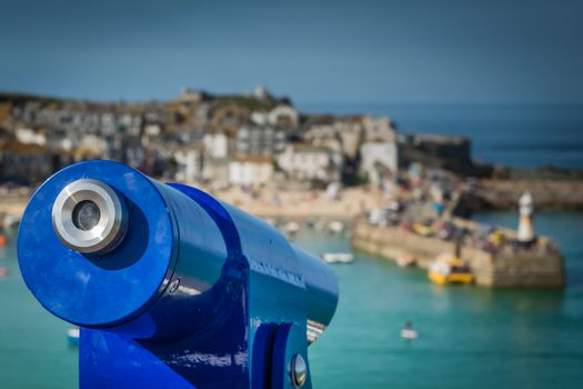 Viewing telescope on the scenic lookout above the beach in St. Ives, Cornwall, England, UK