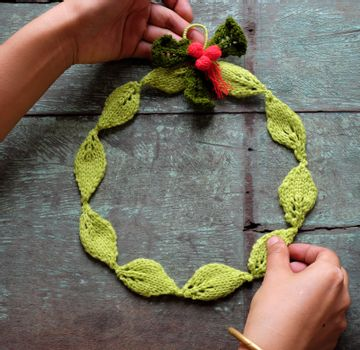 Diy Christmas wreath for decoration the door on Xmas holiday, a traditional festive in winter,  wreath make from knitted green leaf