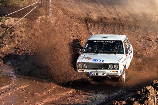 ISTANBUL, TURKEY - NOVEMBER 14, 2015: Emre Hasbay drives Tofas Fiat 131 of Delta Sport Team in Isok Istanbul Rally 2015, Gocbeyli stage