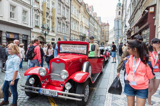PRAGUE, CZECH REPUBLIC - JUNE 27, 2016: Vintage sightseeing tour car waiting for tourists in old town of Prague, Czech Republic