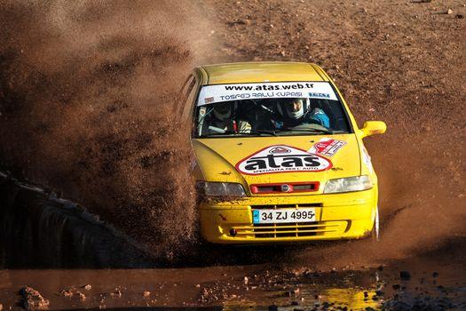 ISTANBUL, TURKEY - NOVEMBER 14, 2015: Murat Guray drives Fiat Palio in Isok Istanbul Rally 2015, Gocbeyli stage