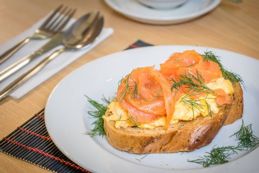 Smoked salmon with scrambled eggs on toast
