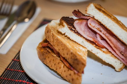 Toasted bread with bacon served for breakfast