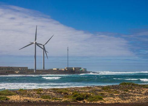 Wind turbines on the coast in Corralejo, Fuerteventura, Canary Islands, Spain