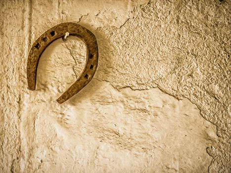 Horseshoe hanging on a wall in a barn in a farm