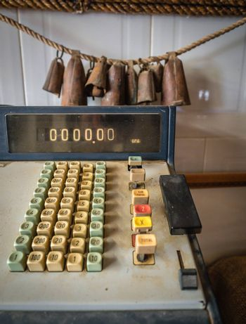 Details of an dirty old rusty vintage cash register