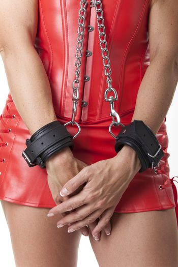 woman in a leather corsage in chains