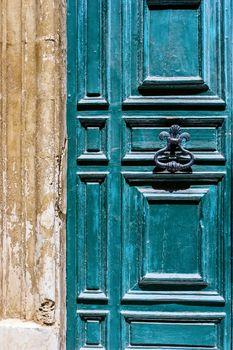 Blue maltese door