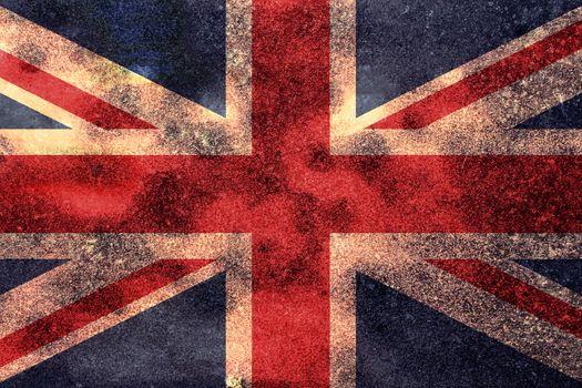 The Great Britain Union Jack flag worn vintage background.