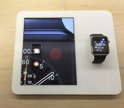 Apple watch displayed and video in store.   NEW YORK,  UNITED STATES AMERICA - APR 25 2015: New Apple Watch smartwatch displaying inside a glass cabinet, New York, USA
