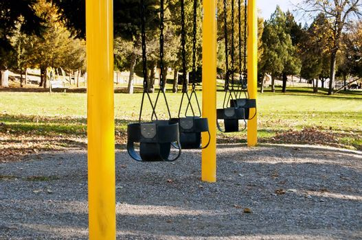 Wheatland, Wyoming USA city park, toddler swings