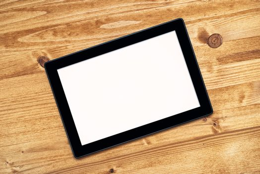Tablet computer with blank screen as copy space on desk