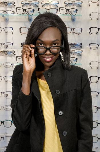 Beautiful woman with her stylish designer glasses