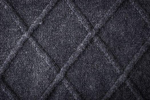 Grey figured sweater background