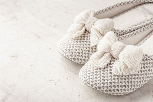Slipper with bow on the white background horizontal