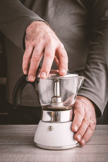 Hands with coffee maker