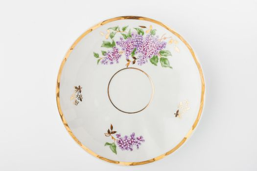 Porcelain plate on the white background