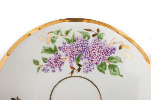 Part of porcelain plate on the white background