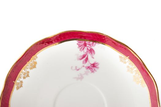 Part of vintage porcelain plate on the white background