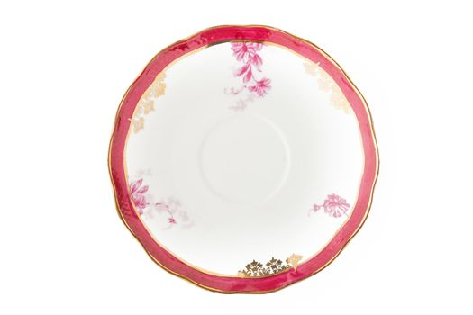 Vintage porcelain plate on the white background