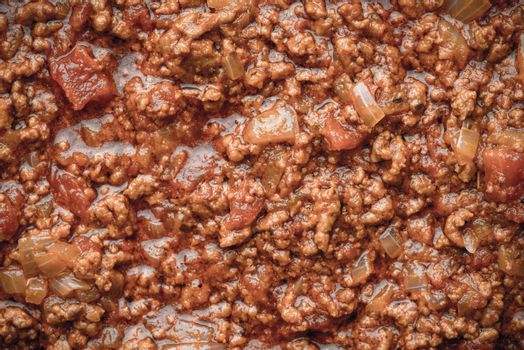 Stew meat with seasoning and tomatoes background