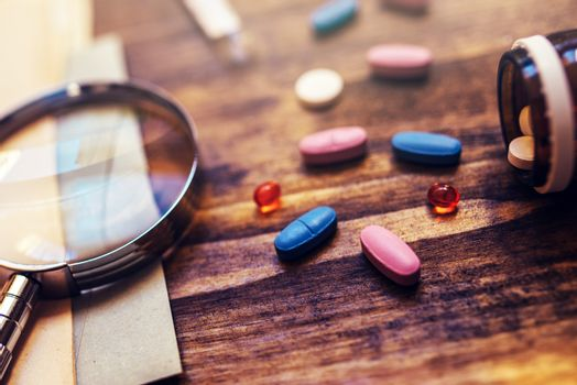 Colorful medical tablets and pills on doctor's office desk