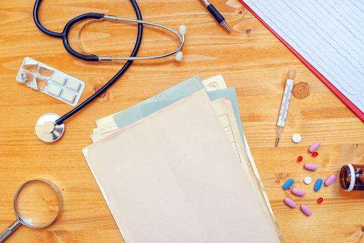 Assorted office supplies on general medical practitioner work de