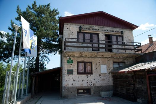 Sarajevo, Bosnia - July 7, 2016: The house through which Sarajevo Tunnel connected the city with other parts during the Siege of Sarajevo constructed in 1993. Note the bullet holes on walls.