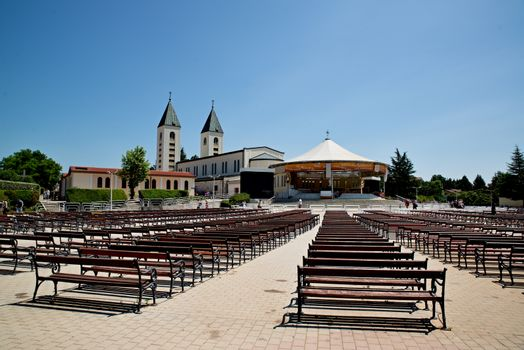 MEDUGORJE, BOSNIA AND HERZEGOVINA - JULY 4, 2016: Benches and altar behind the parish church of St. James, the shrine of Our Lady of Medugorje