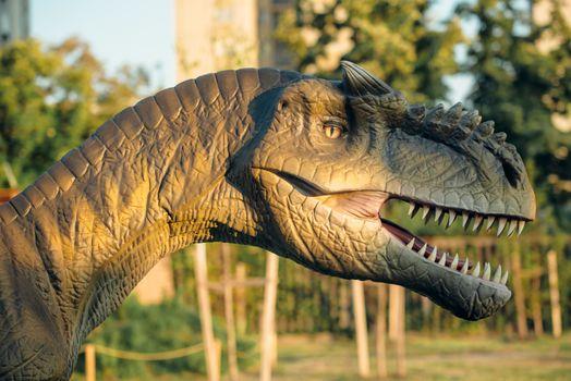 NOVI SAD, SERBIA - AUGUST 5, 2016: Allosaurus life size model of prehistoric animal in theme entertainment Dino Park. This large theropod dinosaur lived 155 to 150 million years ago.