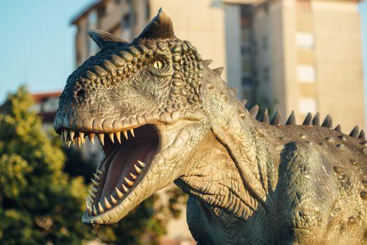 NOVI SAD, SERBIA - AUGUST 5, 2016: Carnotaurus life size model of prehistoric animal in theme entertainment Dino Park. This was bipedal predator, measuring 8 to 9 m.