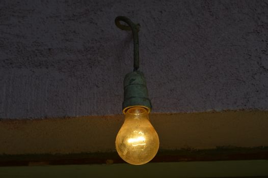 Old dusty light bulb on a cable