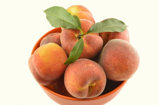 Bowl of delicious peaches