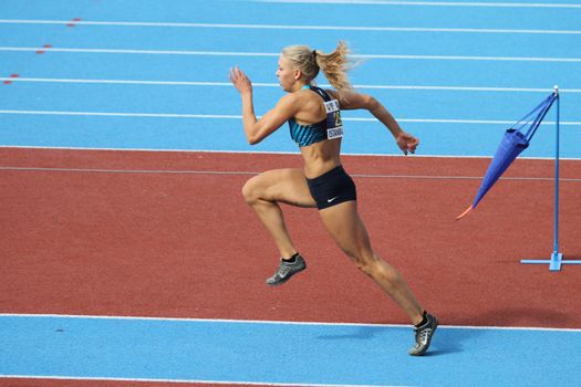 ISTANBUL, TURKEY - SEPTEMBER 19, 2015: Athlete Laura Tollose long jump during European Champion Clubs Cup Track and Field Juniors Group A