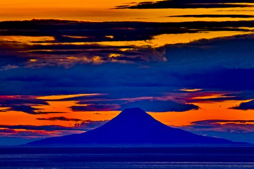 Sunset view of Augustine Volcano from Homer in Alaska