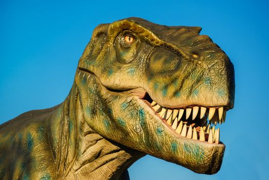 NOVI SAD, SERBIA - AUGUST 5, 2016: Tyrannosaurus life size model of prehistoric animal in theme entertainment Dino Park. T-rex was one of the largest land carnivores of all time.
