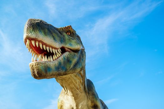 NOVI SAD, SERBIA - AUGUST 7, 2016: Tyrannosaurus life size model of prehistoric animal in theme entertainment Dino Park. T-rex was one of the largest land carnivores of all time.