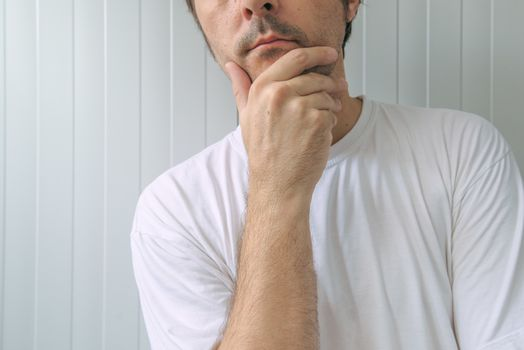 Man with hand on chin thinking deep thoughts