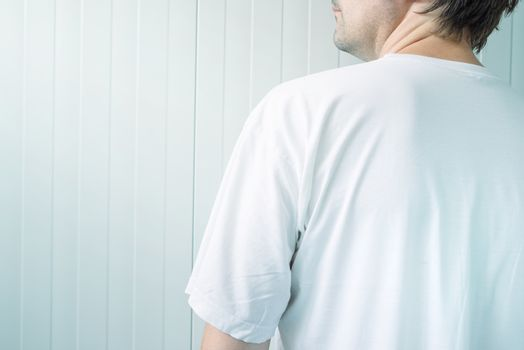 Man in white shirt from behind
