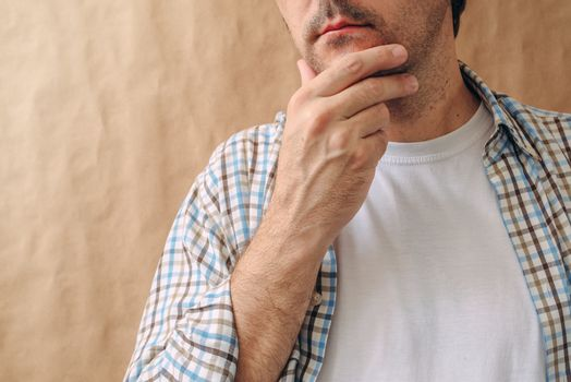 Man stroking chin and thinking deep thoughts