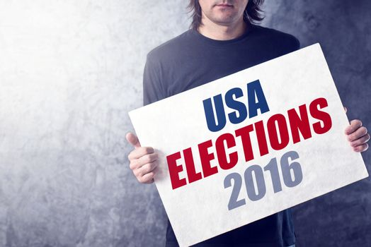 USA elections 2016, man holding poster
