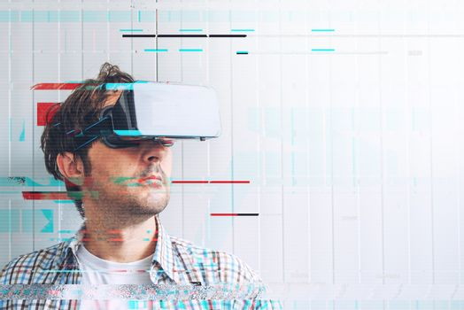 Man with VR goggles exploring virtual reality econtent
