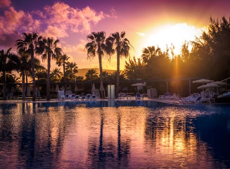 Large swimming pool in a resort in Fuerteventura at sunset, Canary Islands, Spain