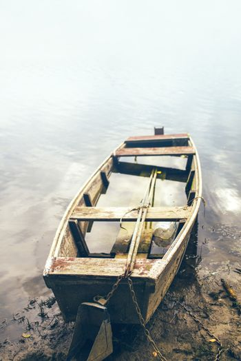 Old fishing boat on riverbank